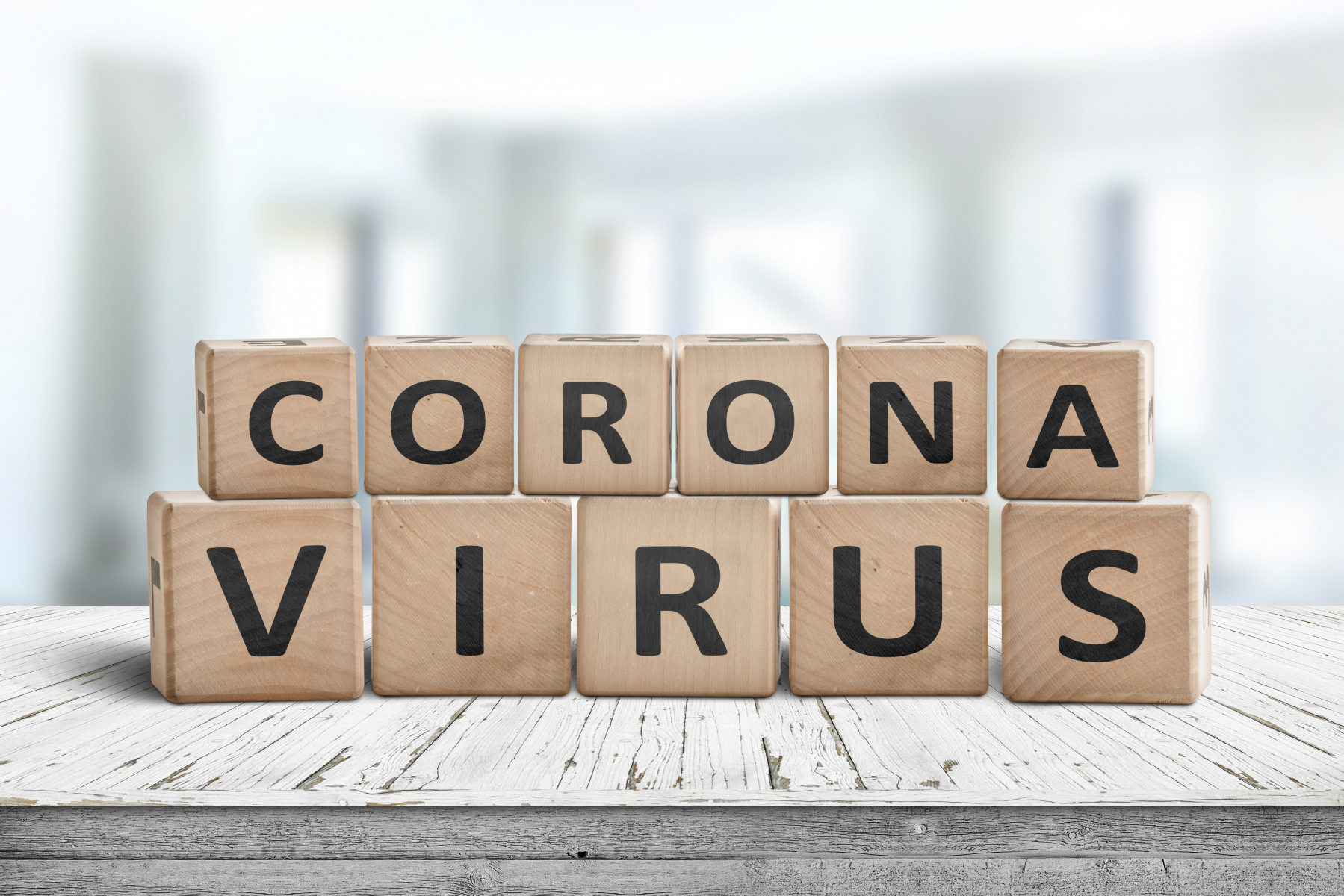 35849192-corona-virus-alert-message-on-a-worn-wooden-desk